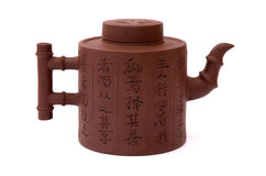 Clay chinese teapot. Brown chinese teapot from clay with hieroglyphic on white background Stock Image