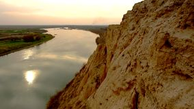 Clay cliff on the river bank. Sunset of the spring day stock footage