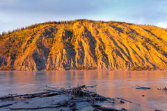 Clay cliff at Yukon River near Dawson City Royalty Free Stock Images