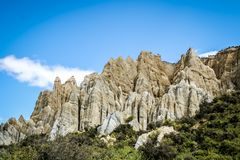 The Clay Cliffs are a famous attraction in New Zealand. Its tall pinnacles are separated by narrow ravines. These natural rock stock images
