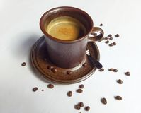 Clay coffee cup. And seed Stock Photography
