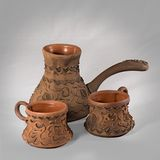 Clay coffee set with two cups Stock Images