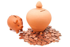 Clay coin piggy bank Stock Photos