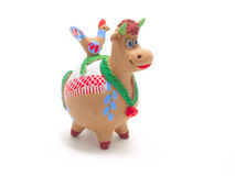 Clay cow. Isolated clay figurines cow with a bird on his back Stock Photography