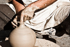 Clay craftsman. Craftsman potter making a clay pot Royalty Free Stock Photography