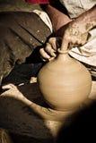 Clay craftsman. Craftsman potter making a clay pot Royalty Free Stock Photo