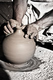 Clay craftsman. Craftsman potter making a clay pot Stock Images