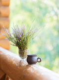 Clay cup with coffee and  bouquet. Stock Images