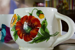 Clay cup with floral pattern Stock Photography