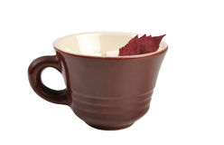Clay cup with leaf Royalty Free Stock Photos
