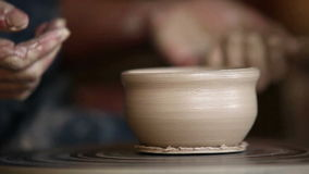 Clay cup is made by a potter traditionally on a potter`s wheel stock video
