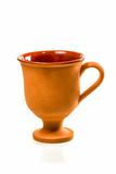 Clay cup without pictures. Brown clay cup on a high leg without pictures isolated on white background Stock Photos