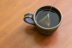 Clay Cup of tea with teabag.  Top view. Royalty Free Stock Photography