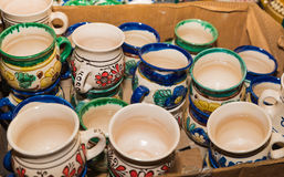 Clay cups. Exhibited for sale at the fair in Bucharest, Romania royalty free stock photos