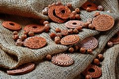 Clay decorations. Many clay ornaments lying in one place stock photos