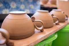 Clay dishes on old wooden backgroung Royalty Free Stock Photography