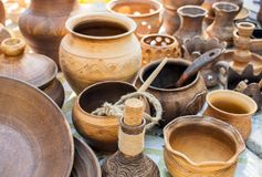 Clay dishes. Traditional rustic crockery. Brown and beige potter stock photography
