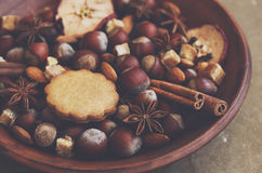 Clay display with gingerbread cookies, spices, nuts and sugar Stock Photos