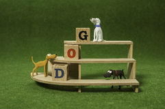 Clay dog on the shelf with wooden alphabet cube Royalty Free Stock Photos