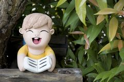 Clay doll in garden Stock Image