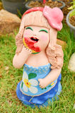 Clay doll statue for used decoration in garden or home Royalty Free Stock Photo