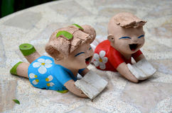 Clay dolls children boy and girl reading book Royalty Free Stock Photo