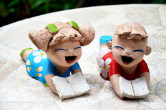 Clay dolls children boy and girl reading book Royalty Free Stock Image