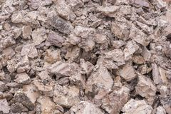 Clay earth in a heap after excavating a pit royalty free stock image