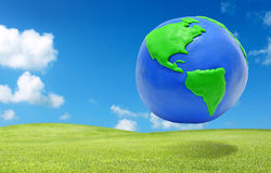 Clay earth over the green grass field eco concept Stock Photos