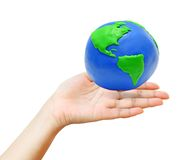 clay earth over the young hand Royalty Free Stock Photo