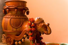 Clay elephant with a chariot and a flower garland. Clay elephant made of clay and glazed with a pitcher as a chariot and wearing a garland of flowers Stock Images