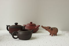 Clay elephant and three clay pot Stock Image