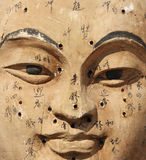 Clay face with acupuncture points. For Chinese traditional medicine stock photos