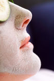 Clay Face Mask. Close up detail of female face wearing Clay Face Mask, with Cucumber slices on her eyes Stock Images