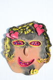 Clay face of smiling girl with hearts Royalty Free Stock Photo
