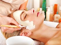 Clay facial mask in beauty spa. Stock Images