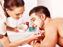 Clay facial mask in beauty spa. Stock Photo