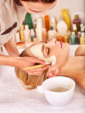 Clay facial mask in beauty spa Stock Image