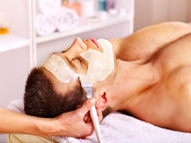 Clay facial mask in beauty spa. royalty free stock photography