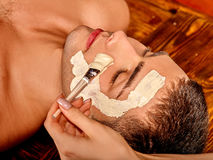 Clay facial mask in beauty spa Royalty Free Stock Photography