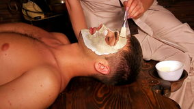 Clay facial mask in beauty spa. stock video footage