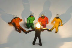 Clay figures. With bulb head shining, open arms stock image