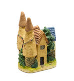 Clay figurine of castle. Back of clay miniature castle with green trees stock images