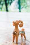 Clay figurine sheep. Whistles Royalty Free Stock Photography