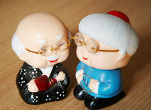 Clay figurines of cartoon couple stock photo