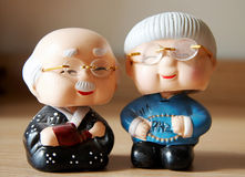 Clay figurines of cartoon couple. Cartoon clay figurine of an asian couple Royalty Free Stock Images