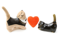 Clay figurines of cats with golden ornaments. Stock Photos
