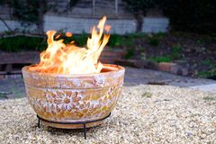Clay Fire Pit in Back Garden Stock Image