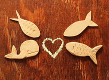 Clay  fishes and heart Royalty Free Stock Photos