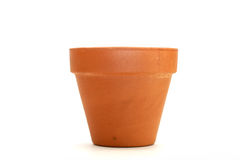 Clay flower pot. Isolated on a white background Stock Photos